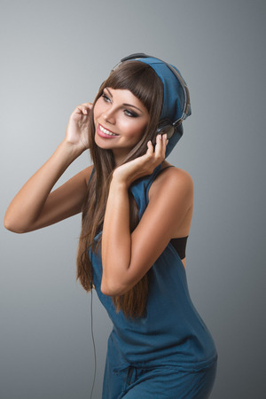 Young modern woman listening music in headphones photo