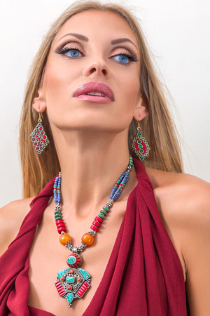 Young fashion woman posing with traditional indian jewelery photo