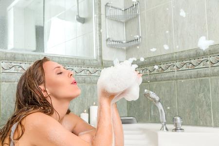sexy shower: Young beautiful woman relaxing in a bath Stock Photo
