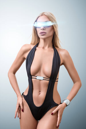 futuristic girl: Young fashion futuristic woman posing with virtual reality cyberspace glasses