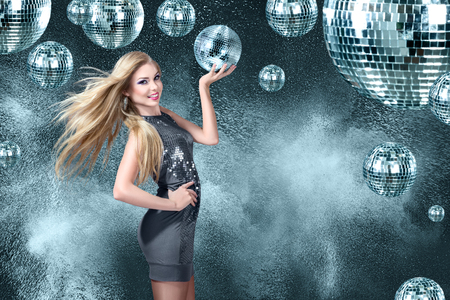 Young blonde woman dancing at night disco club photo
