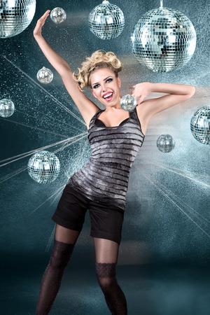 dancing club: Young blonde woman dancing at night disco club