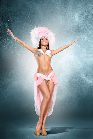 stage costume: Beautiful young samba dancer in pink stage costume
