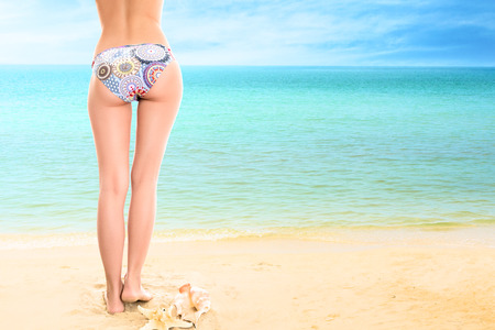 Young woman looking at tropical sea. Rear view outdoor Stock Photo - 28624443