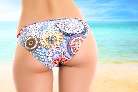 Young woman looking at tropical sea. Rear view outdoor Imagens