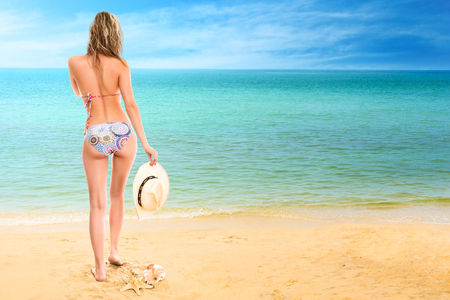 Young woman looking at tropical sea. Rear view outdoor Stock Photo - 28624445