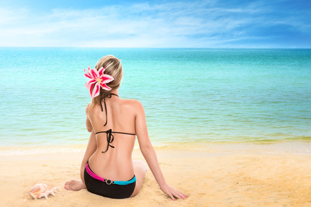 Young woman looking at tropical sea. Rear view outdoor Stock Photo - 28624449