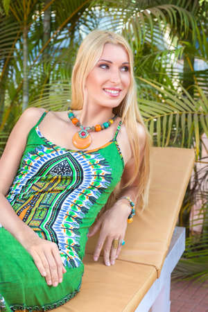 Young blonde woman relaxing at tropical resort photo