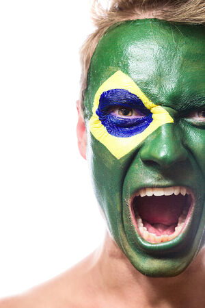 face paint: Soccer fan with brazil flag painted over face Stock Photo