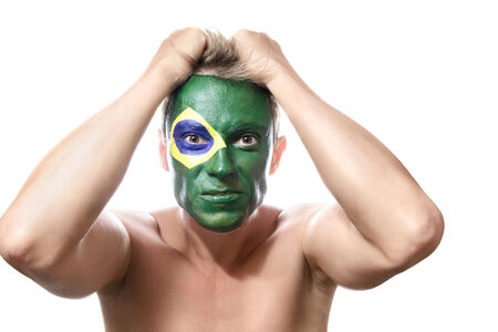 supporter: Soccer fan with brazil flag painted over face Stock Photo