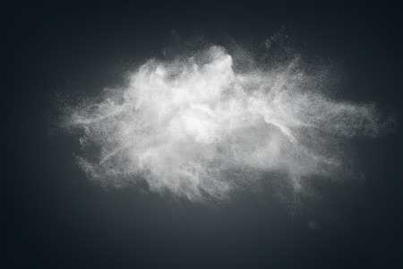 Abstract design of white powder cloud against dark background