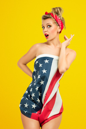 american sexy: Sexy blond classic retro style pin-up model wrapped in american flag