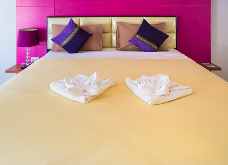 king size bed: Big king size double bed in hotel bedroom Stock Photo