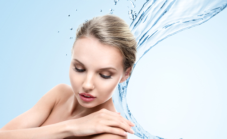 Design of young woman with clean water splash photo