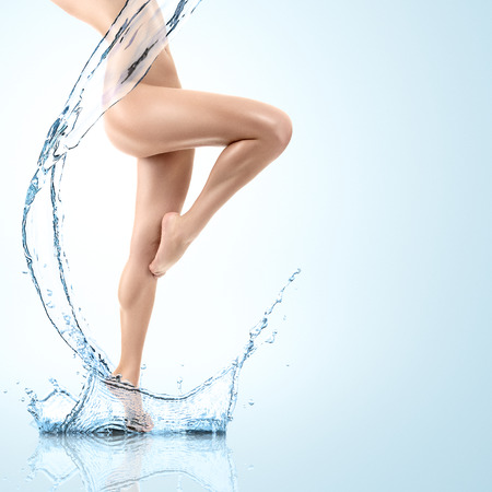 nude female body model: Design of young woman body with clean water splash Stock Photo