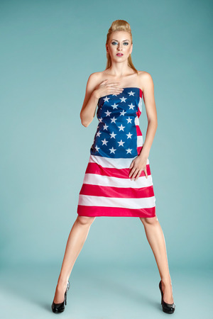 Beautiful pin-up style fashion model in dress made from american flag photo