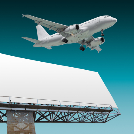 Design of commercial airliner flying above billboard with empty background photo