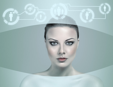 tecnology: Abstract futuristic woman looking at data flow in a virtual display Stock Photo