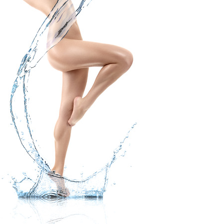 Design of young woman body with clean water splash isolated on white background photo