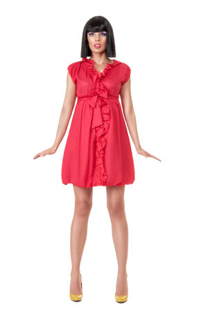 manequin: Young sexy woman in red mini dress posing like doll isolated on white background Stock Photo
