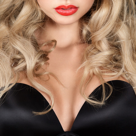 mouth close up: Beautiful blonde young woman with long hair studio portrait