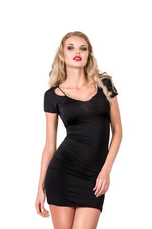 mini dress: Beautiful young slim woman studio portrait isolated on white background