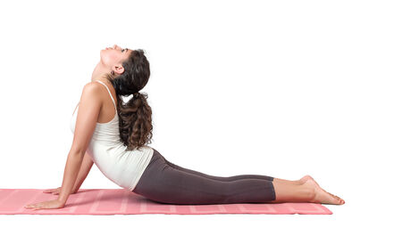 COBRA: Portrait of young woman performing yoga asana