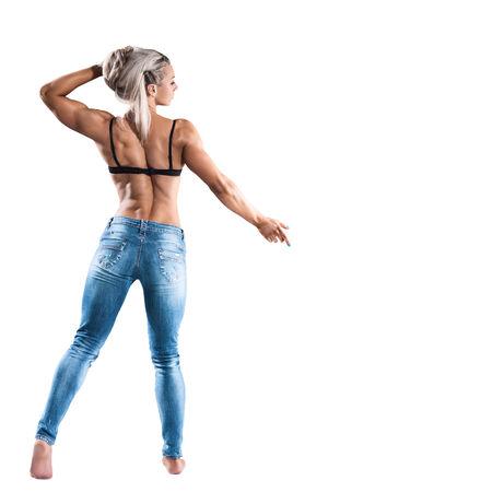 mujer deportista: Atlético joven posando aislados sobre fondo blanco Foto de archivo