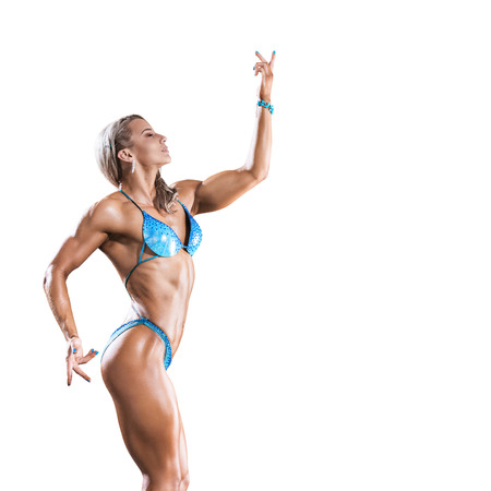 female fitness: Athletic young woman posing isolated on white background Stock Photo
