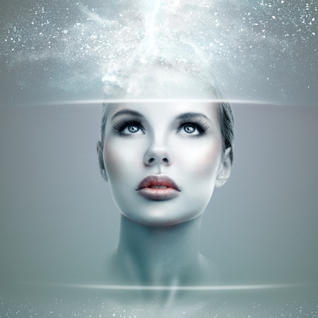 tecnology: Abstract futuristic woman looking on a virtual display