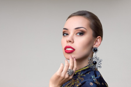 finery: Young sexy woman with beautiful makeup studio oriental style portrait