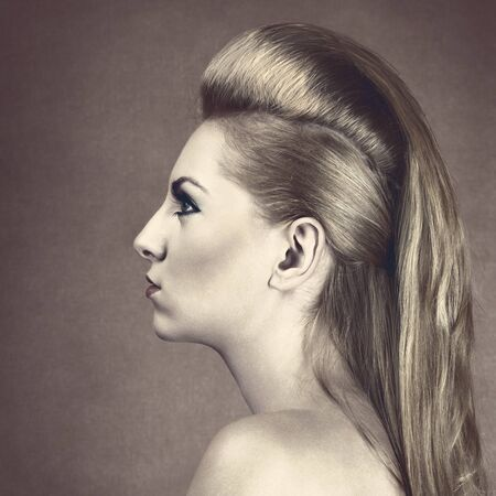 sidewards: Young blond woman with long fashionable hairstyle
