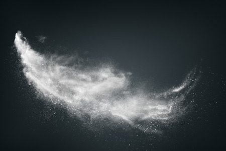 storms: Abstract design of white powder cloud against dark background