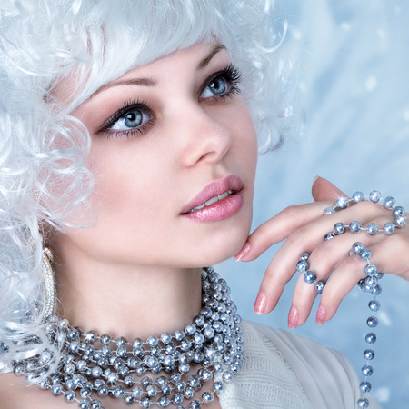 Elegant young fashion woman with snow frost winter make-up photo