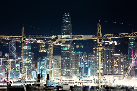 Night view of construction site with cranes in Hong Kong Imagens