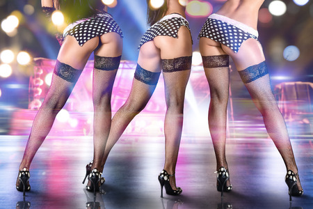 stage costume: Group of sexy women dancing on stage in night club.