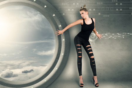 futuristic girl: Young woman in futuristic interior playing science fiction crime scene
