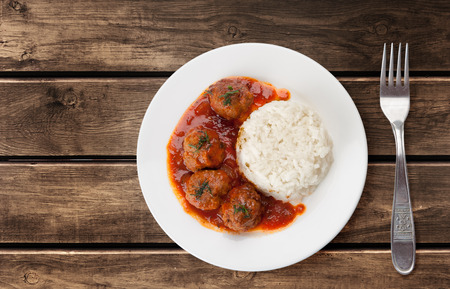 Traditional roasted meatballs with rice and tomato sauce Stok Fotoğraf - 39655808