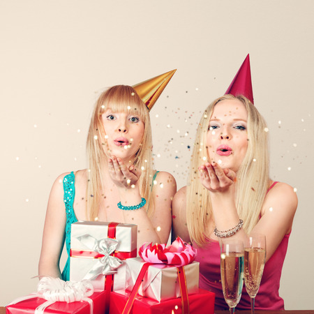 birthday champagne: Two young beautiful blonde women celebrating birthday Stock Photo