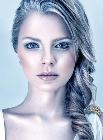 winter fashion: Beautiful young fashion model with winter ice style makeup