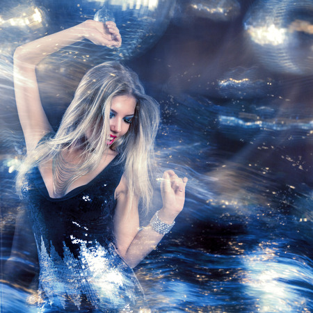 Young beautiful woman at night disco club