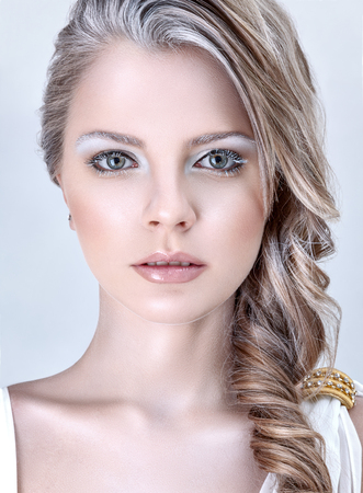 woman hairstyle: Beautiful young fashion model with winter ice style makeup