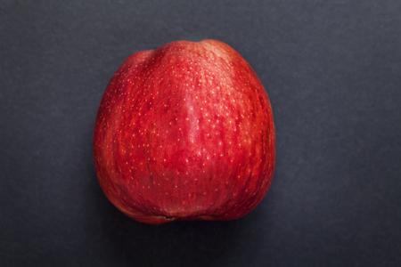dark red: Red fresh apple on dark gray background