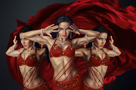 sexy girl dance: Beautiful belly dancer perfoming exotic dance in red flutter dress