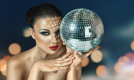 discoball: Young beautiful woman at night disco club