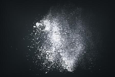 tornado: Abstract design of white powder cloud against dark background