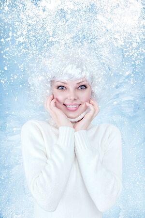 frozen winter: Frozen beautiful young woman fashion winter portrait