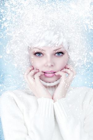a blizzard: Frozen beautiful young woman fashion winter portrait