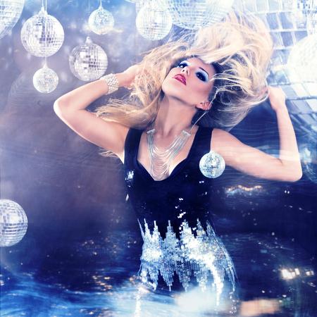 dancing club: Young blonde woman dancing at night disco club. Motion blur