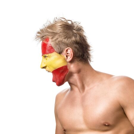 soccer fan: Football fan with spain flag painted over face isolated on white background Stock Photo